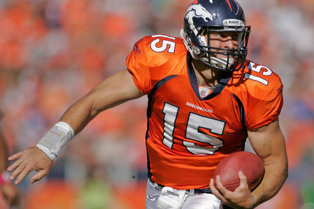 DENVER - OCTOBER 17:  Quarterback Tim Tebow #15 of the Denver Broncos runs for a touchdown against the New York Jets at INVESCO Field at Mile High on October 17 2010 in Denver Colorado.  (Photo by Justin Edmonds/Getty Images)