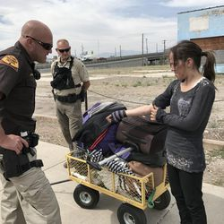 Tawnee, a woman with a long history of drug addiction, shows fresh track marks on her arm to a Utah Highway Patrol trooper working as part of Operation Rio Grande in Salt Lake City on Monday, Aug. 14, 2017. Tawnee was arrested on 13 outstanding warrants.