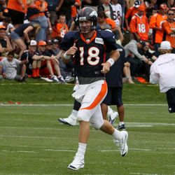 Peyton Manning jogs over to the next drill at training camp