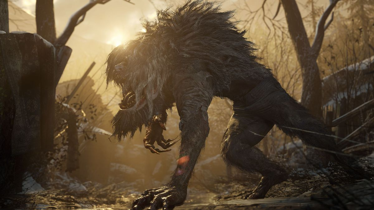 A werewolf-like beast prowls around a wooded area at sunset in Resident Evil Village
