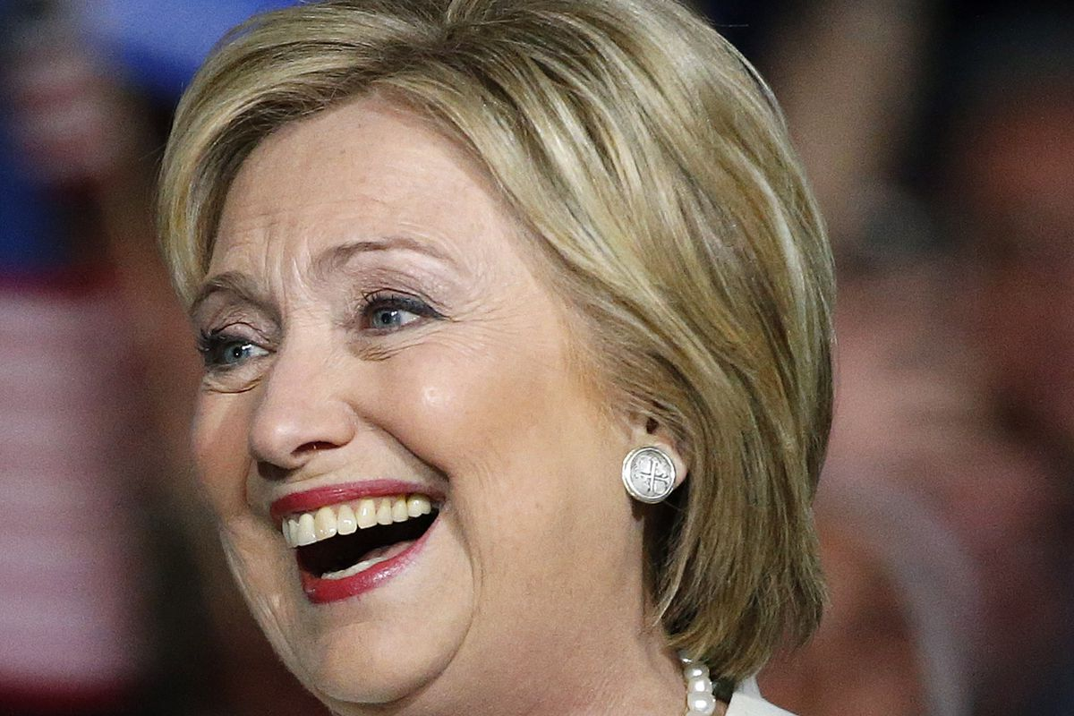 Democratic presidential candidate Hillary Clinton laughs as she addresses her supporters at a rally during a campaign event on Super Tuesday in Miami on March 1, 2016.