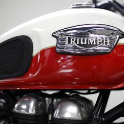 In this Thursday, March 15, 2012 photo, a motorcycle is seen on the Manayunk Triumph showroom floor in Philadelphia. Orders for durable goods dropped 4.2 percent in March, the steepest fall since January 2009, the Commerce Department said Wednesday, April 25, 2012. (AP Photo/Matt Rourke)