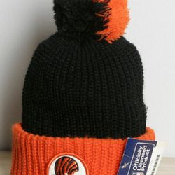 """If all you know about him is his favorite sports team, here's a  <b>retro NFL beanie</b>, <a href=""""http://sockhopny.com/shop/index.php?product=010Retro+Beanie&c=2"""">$25</a> at The Sock Hop"""