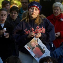 20-year old Julie Black holds a photo of Elizabeth Smart at the Candlelight vigil at Liberty Park for 14-year, Elizabeth Smart, who was kidnapped.