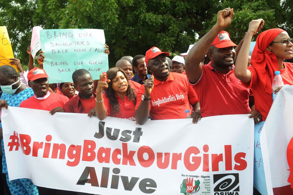 Nigerians rally for the return of the kidnapped girls in Abuja, Nigeria's capital.