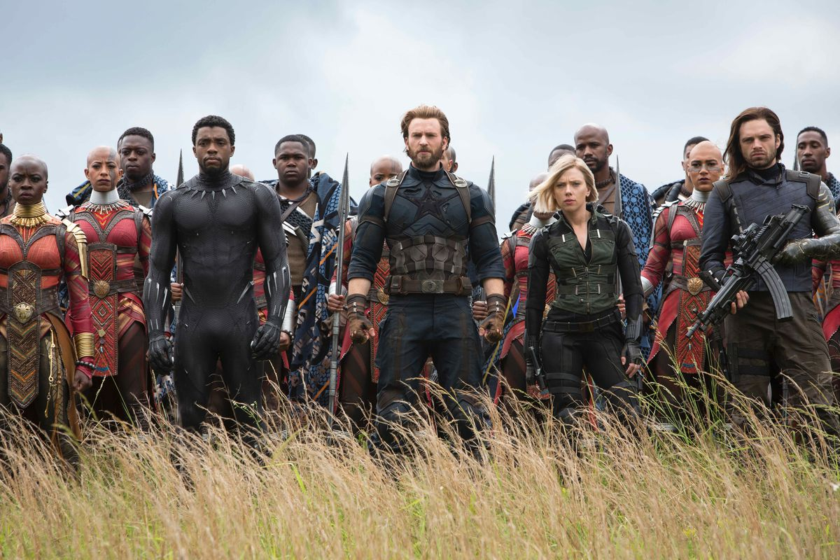 """The characters in """"Avengers: Infinity War"""" line up in a grassy field to face their opponents."""