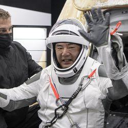 Crew-1 member and Japan Aerospace Exploration Agency (JAXA) astronaut Soichi Noguchi is hoisted out of Crew Dragon.
