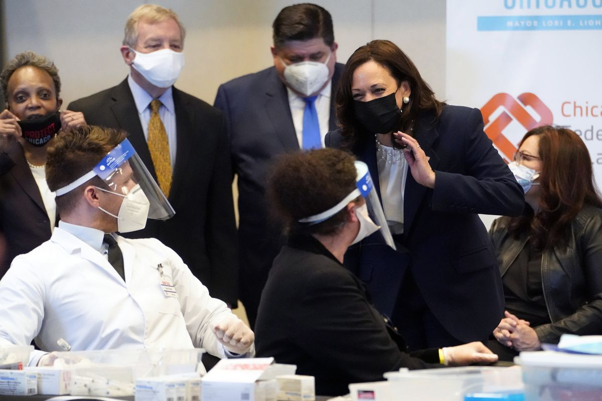 Vice President Kamala Harris speaks during visit to a COVID-19 vaccination site Tuesday, April 6, 2021, in Chicago. Listening are Chicago Mayor Lori Lightfoot, Sen. Dick Durbin, D-Ill., Illinois Gov. J.B. Pritkzer and Sen. Tammy Duckworth, D-Ill., right. The site is a partnership between the City of Chicago and the Chicago Federation of Labor.
