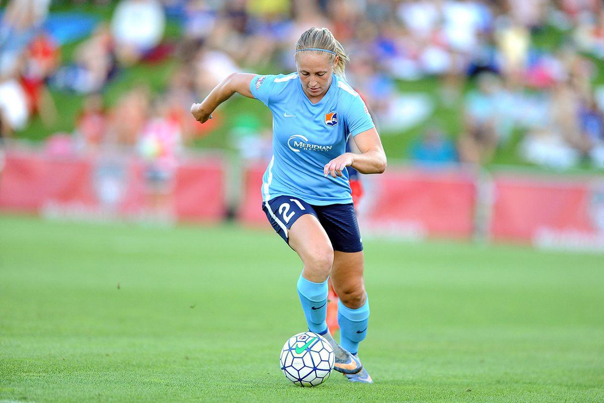 Leah Galton runs a ball down the field.
