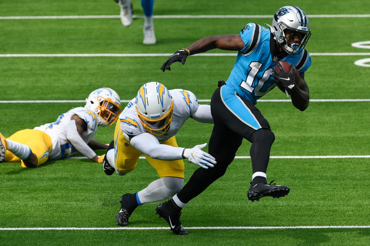 Carolina Panthers wide receiver Curtis Samuel (10) breaks free from Los Angeles Chargers linebacker Kenneth Murray (56) during the first half at SoFi Stadium.