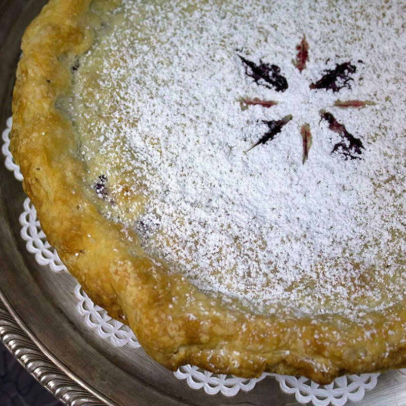 A pie dusted with powdered sugar