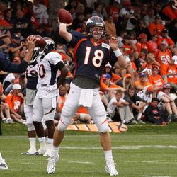 Denver Broncos quarterbacks Brock Osweiler and Peyton Manning work with WRs during training camp's day 4