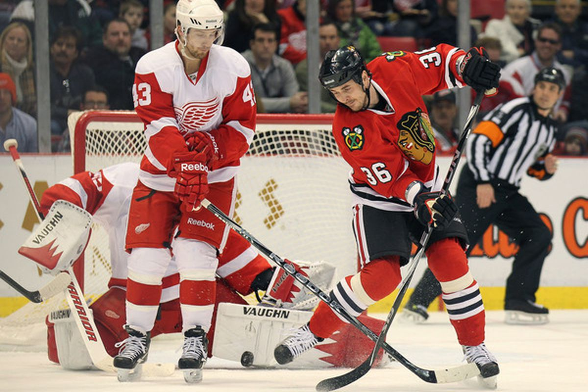DETROIT MI - JANUARY 22:  David Bolland #36 of the Chicago Black Hawks tips a shot at Jimmy Howard #35 of the Detroit Red Wings in a game on January 22 2011 at the Joe Louis Arena in Detroit Michigan. (Photo by Claus Andersen/Getty Images)