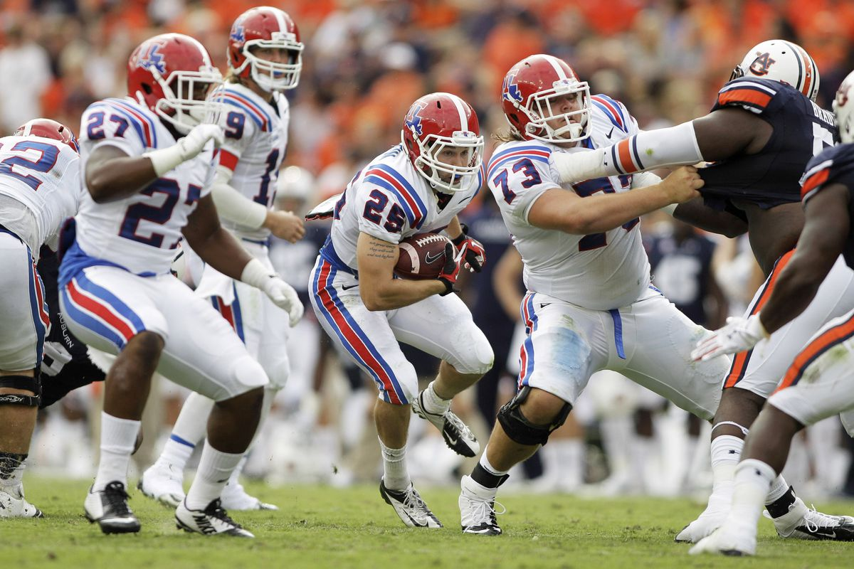 Kirby Wixson (73) opens up a big hole for Blake Baker against Auburn.