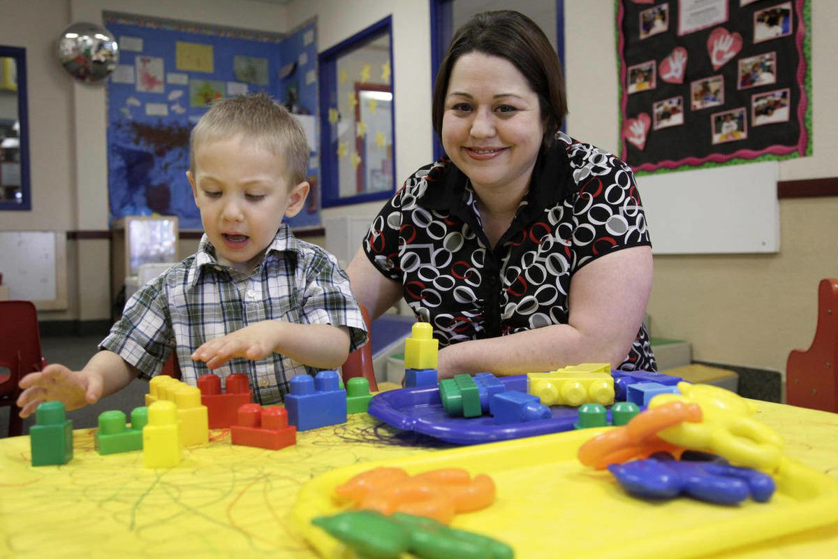 In this April 4, 2012, photo, Kelly Andrus plays with her son Bradley, in his classroom at Children's Choice Learning Centers Inc., in Lewisville, Texas. Bradley, who turns three in a couple of weeks, was diagnosed a year ago with mild autism.  For the fi