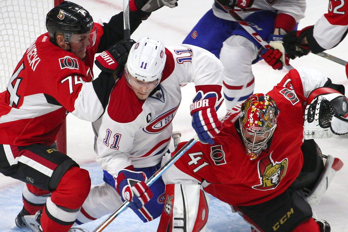 Montreal Canadiens right wing Brendan Gallagher (11) shoots on Ottawa Senators goalie Craig Anderson (41) net as defenseman Mark Borowiecki (74) defends during the second period in game three of the first round of the 2015 Stanley Cup Playoffs
