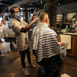 Ace Parkin, City Barbers manager, dries Ed Cable's hair after a haircut at City Barbers on Broadway between 200 East and 300 East in Salt Lake City on Thursday, June 18, 2020.
