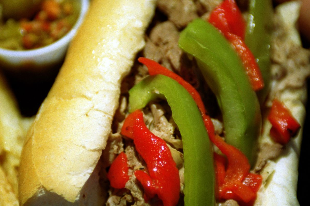 Irfan Khan –– . Italian beef sandwich served with hot and sweet peppers at Giorgios of Chicago, a Ch