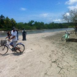 A man on a bike looks back at cracks in the ground after an earthquake along the beach in Cangrejal, Costa Rica, Wednesday, Sept. 5, 2012.  A powerful, magnitude-7.6 earthquake shook Costa Rica and a wide swath of Central America on Wednesday.