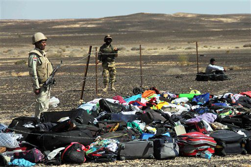 Egyptian Army soldiers stand near luggage and personal effects of passengers on Sunday, a day after the jet bound for St. Petersburg, Russia, crashed. | AP photo