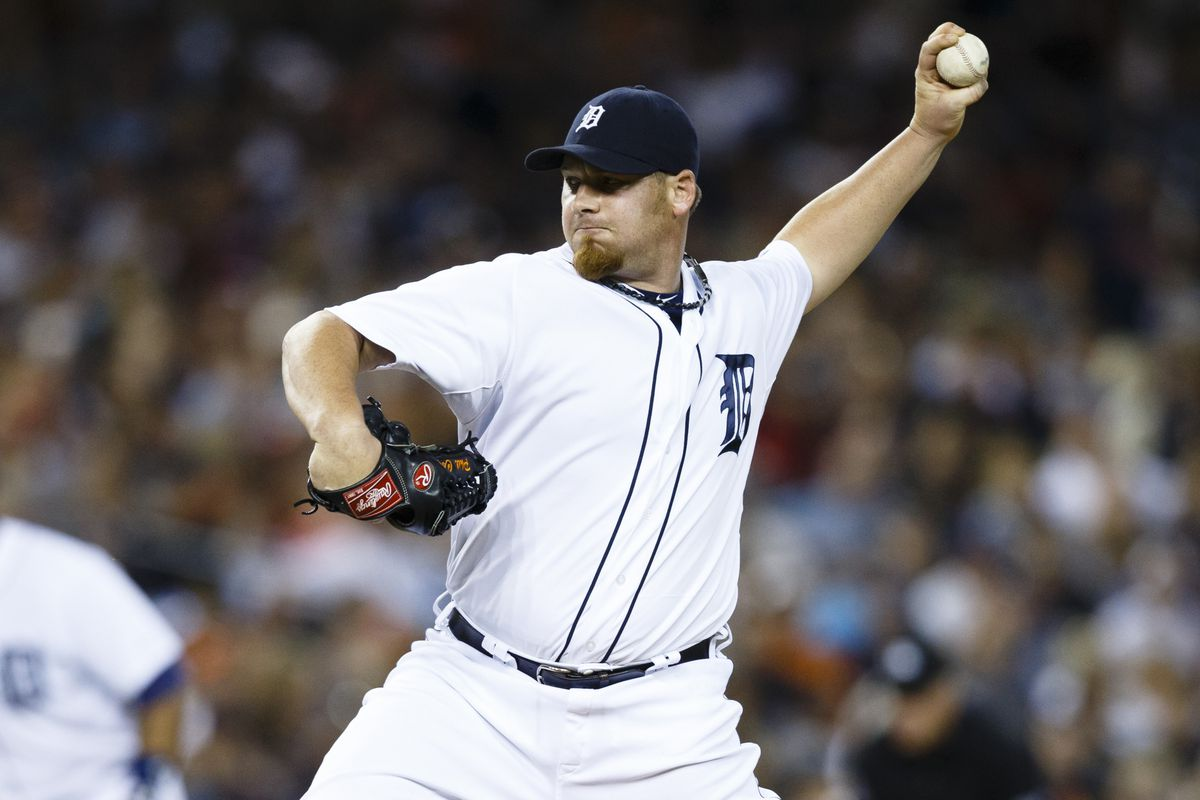 August 18, 2012; Detroit, MI, USA; Detroit Tigers relief pitcher Phil Coke (40) pitches during the eighth inning against the Baltimore Orioles at Comerica Park. Mandatory Credit: Rick Osentoski-US PRESSWIRE