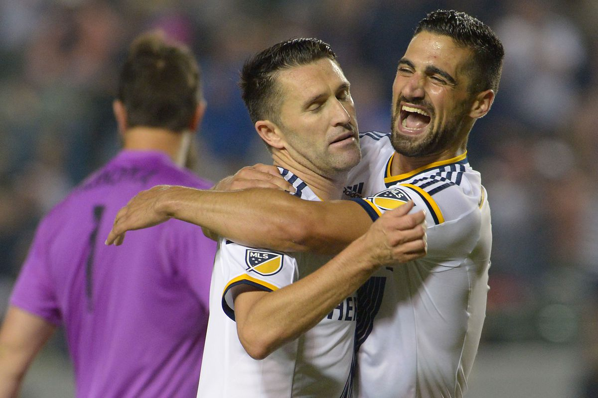 Sebastian Lleget is decidedly more excited than Robbie Keane about Keane's hat trick.