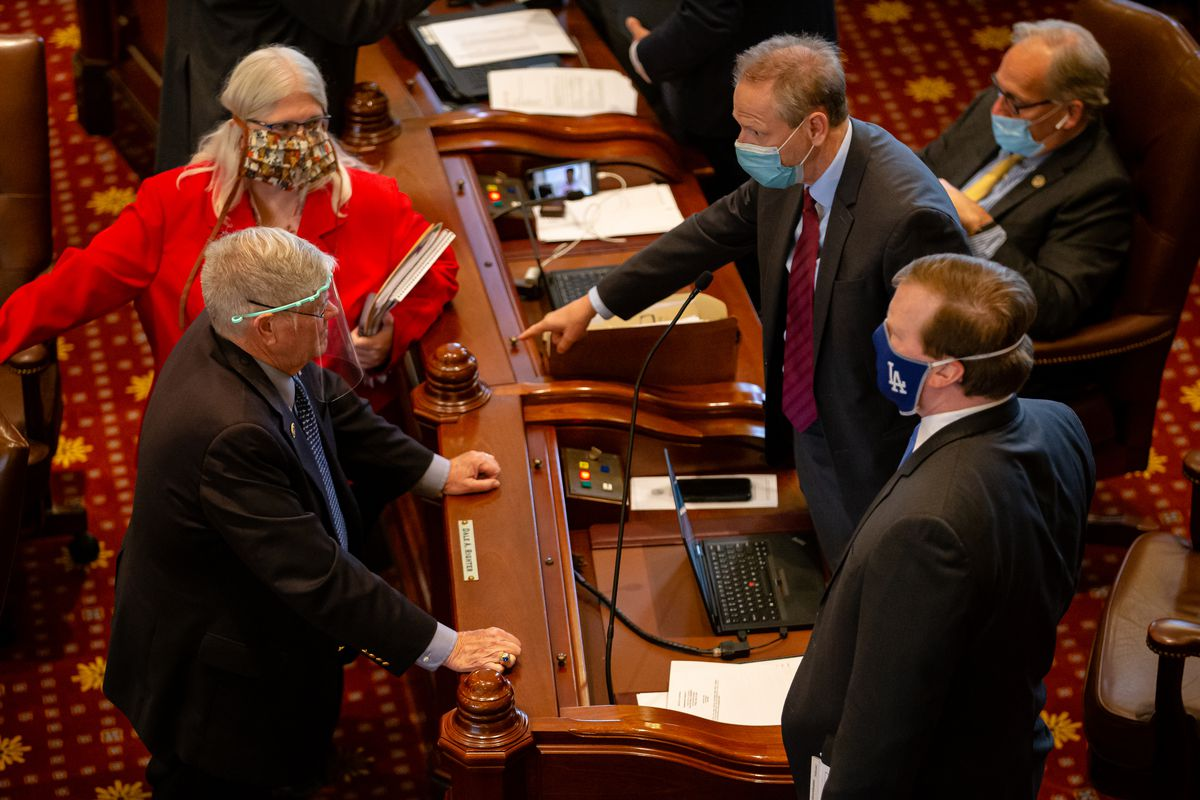 State Sen. Dale Righter, R-Mattoon, gestures as he talks with state Sen. Jim Oberweis, R-Sugar Grove, last May,