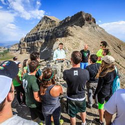 Utah Valley University President Matthew S. Holland speaks with students after a hike on Mount Timpanogos for the Presidential Five Year Stewardship Report on Monday Aug. 11, 2014.