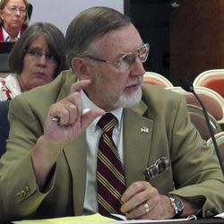 Kansas State Board of Education member Walt Chappell, a Wichita Republican, makes a point during a discussion of declines in students' performance on standardized reading and math tests, Tuesday, Sept. 18, 2012, in Topeka, Kan. The percentage of students meeting or exceeding standards on the tests dropped during the last school year for the first time in 11 years.