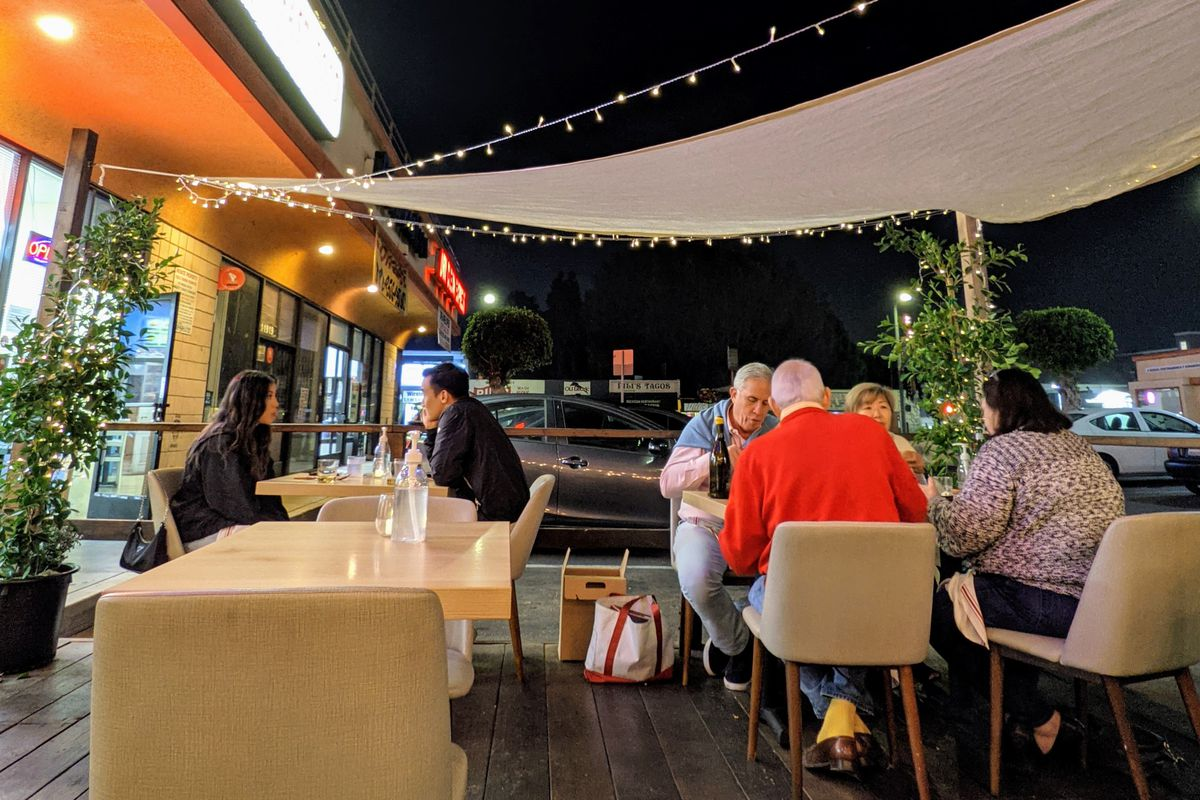 Outdoor dining patio at Kato in West Los Angeles, California.