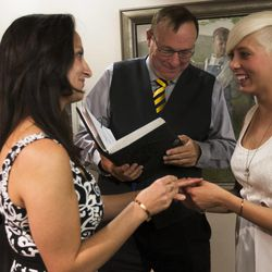 Yolanda Pascua, left, and Laekin Rogers, right, are married by State Sen. Jim Dabakis at the Salt Lake County Clerk's Office in Salt Lake City, Monday, Oct. 6, 2014.