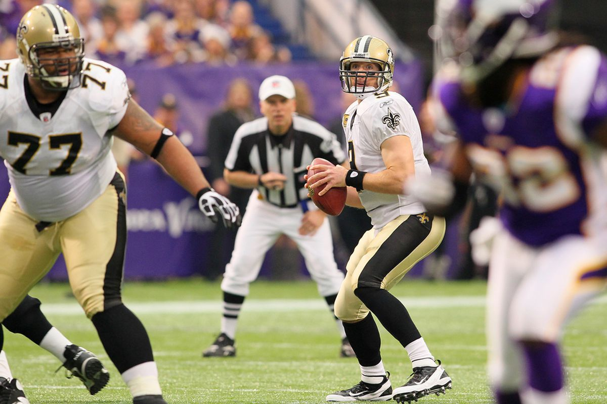 MINNEAPOLIS, MN - DECEMBER 18:    Drew Brees #9 of the New Orleans Saints looks to pass against the Minnesota Vikings at the Hubert H. Humphrey Metrodome on December 18, 2011 in Minneapolis, Minnesota.  (Photo by Adam Bettcher /Getty Images)