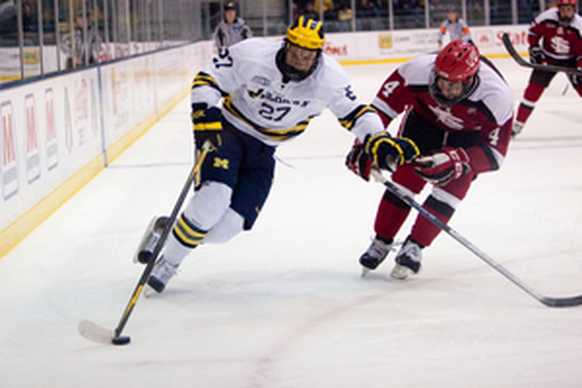 Alex Guptill protects the puck in the offensive zone