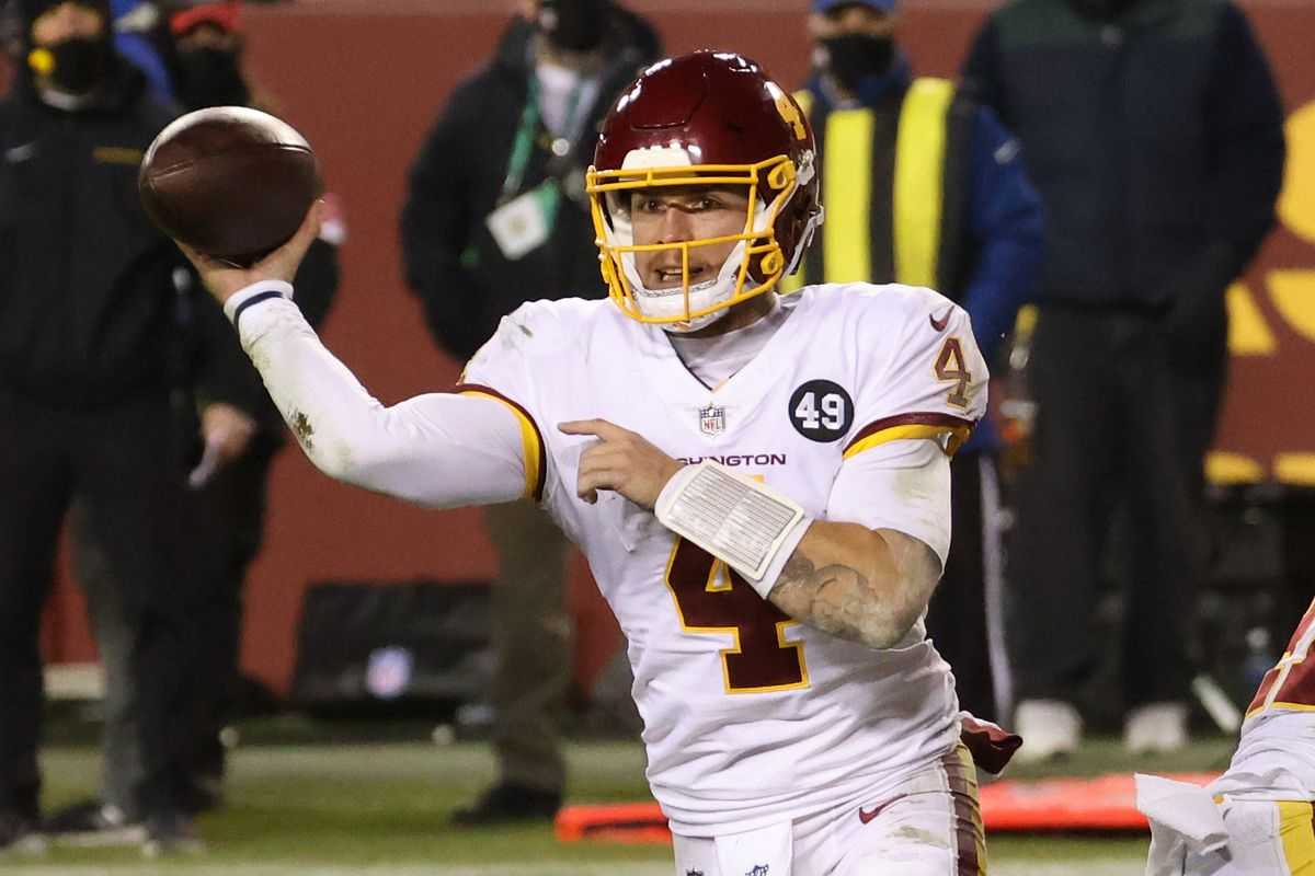 Washington Football Team quarterback Taylor Heinicke (4) passes the ball against the Tampa Bay Buccaneers at FedExField.