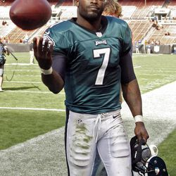 Philadelphia Eagles quarterback Michael Vick tosses a ball to a fan after a 17-16 win over the Cleveland Browns in an NFL football game on Sunday, Sept. 9, 2012, in Cleveland.