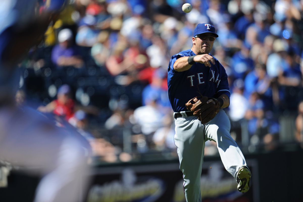 August 5, 2012; Kansas City, MO, USA; Texas Rangers third basemen Mike Olt (9) makes a throw to first for an out against the Kansas City Royals during the seventh inning at Kauffman Stadium.  Mandatory Credit: Peter G. Aiken-US PRESSWIRE