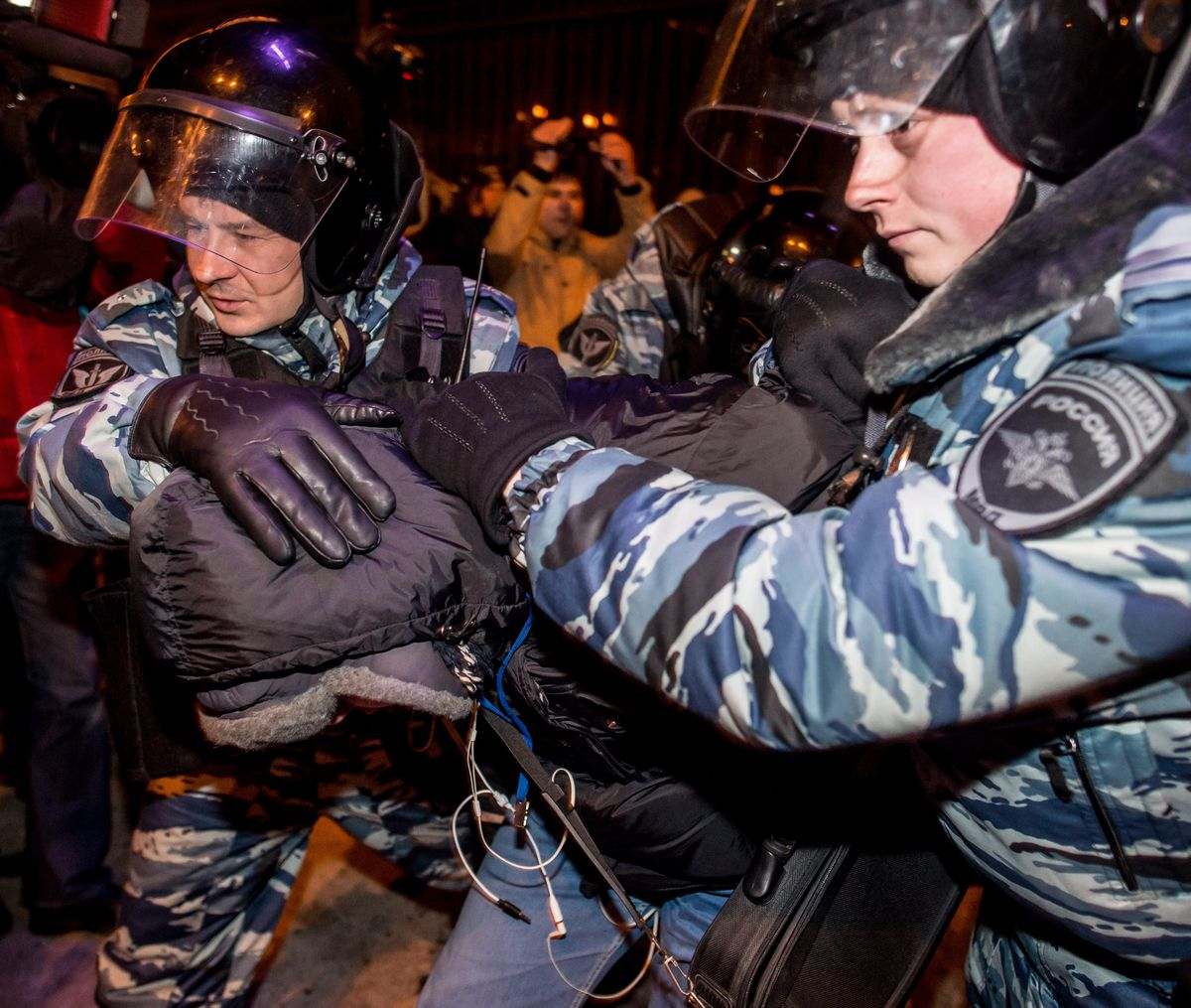 Russian riot police arrest a protester in Moscow (DMITRY SEREBRYAKOV/AFP/Getty)