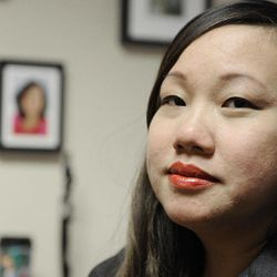 In this Feb. 13, 2012 photo, Yen-Chi Le sits in her Houston office talking about the loss of her mother, pictured on the wall. Le's mother died in a bus crash in North Texas that killed 16 others.