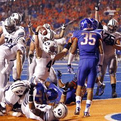 Taysom Hill (4) of the Brigham Young Cougars celebrates scoring BYU's only touchdown during NCAA football in Boise, Thursday, Sept. 20, 2012.