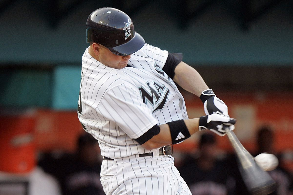 Florida Marlins' Cody Ross hits an RBI single in the first i