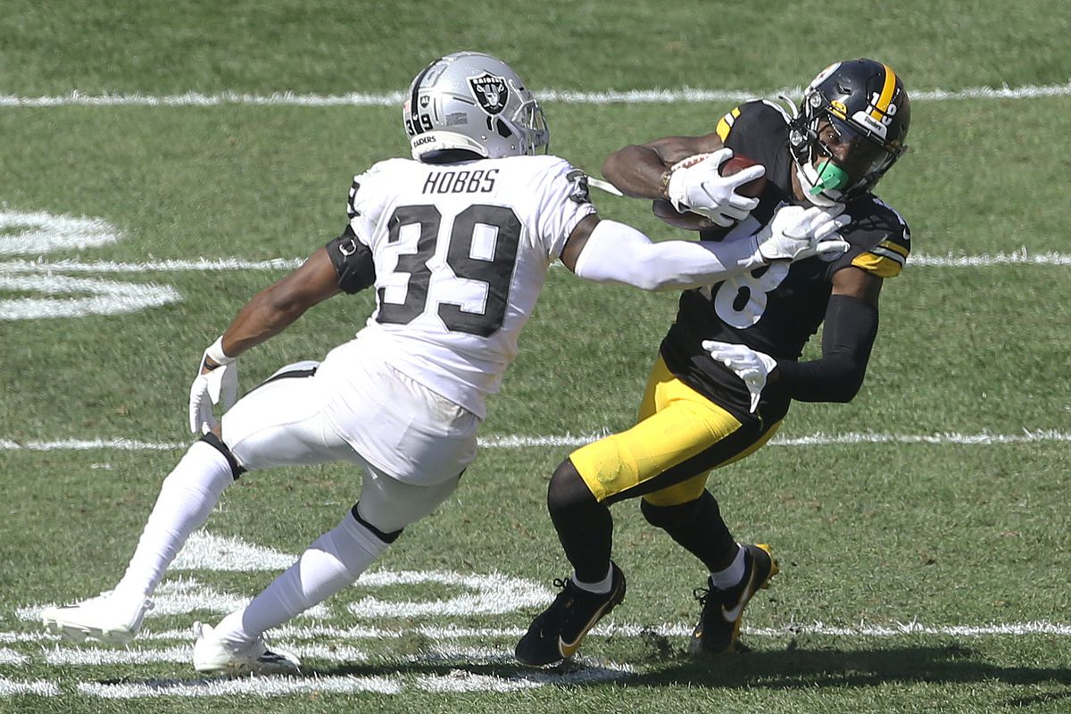 Las Vegas Raiders cornerback Nate Hobbs (39) defends Pittsburgh Steelers wide receiver Diontae Johnson (18) after a catch during the third quarter at Heinz Field. Las Vegas won 26-17.
