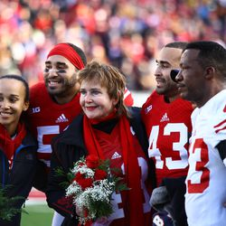 Marcus and Michael Trotter pose for a photo with their family on Senior Day