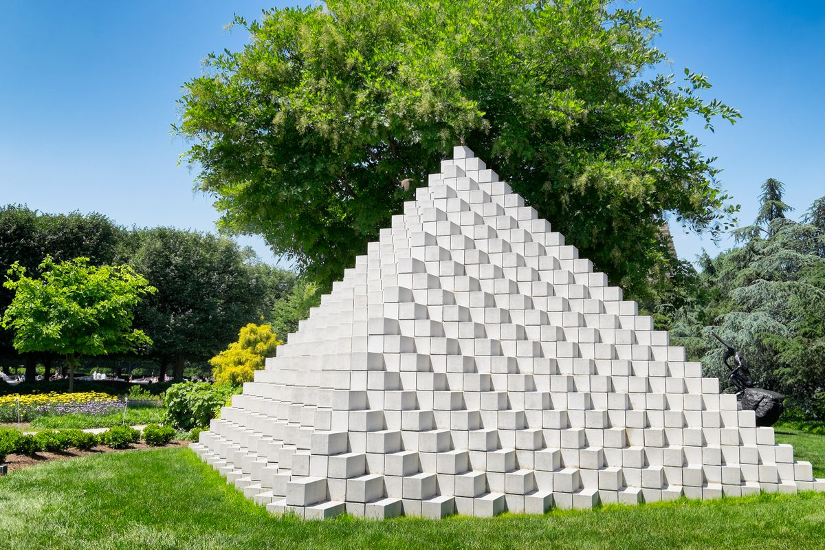 A sculpture of a pyramid in a sculpture garden at the National Gallery of Art.