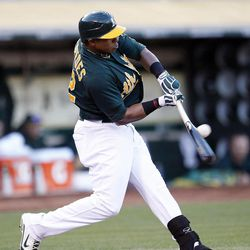 Oakland Athletics' Yoenis Cespedes (52) hits an RBI single against Boston Red Sox starting pitcher Felix Doubront in the third inning of a baseball game Saturday,  Sept. 1, 2012 in Oakland, Calif. Athletics' Jonny Gomes scored from second base.