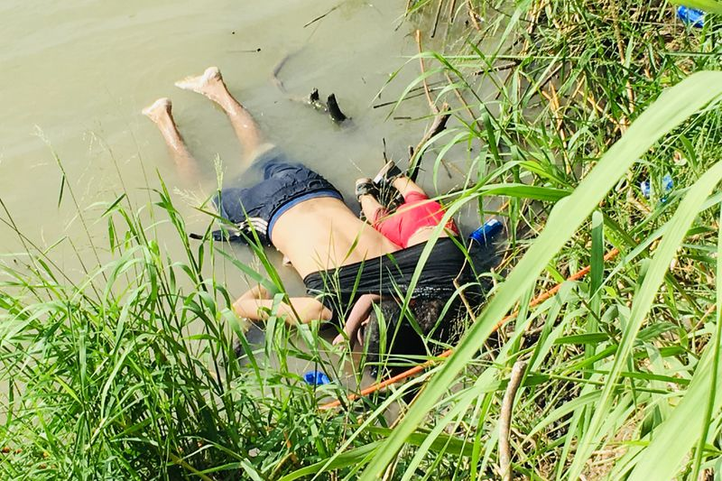 The bodies of Salvadoran migrant Oscar Alberto Martínez Ramírez and his nearly 2-year-old daughter Valeria lie on the bank of the Rio Grande in Matamoros, Mexico, Monday, June 24, 2019, after they drowned trying to cross the river to Brownsville, Texas. M