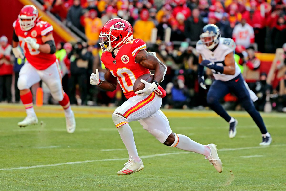 Kansas City Chiefs wide receiver Tyreek Hill runs for a touchdown during the second quarter against the Tennessee Titans in the AFC Championship Game at Arrowhead Stadium.