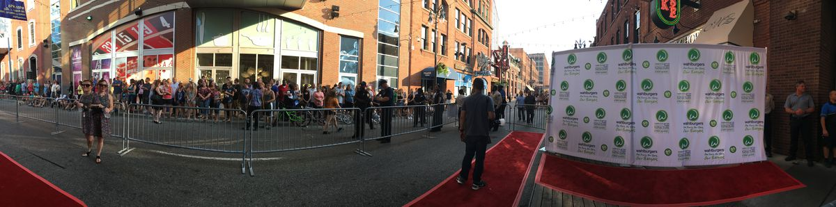 Crowds gathered across the street at the Wahlburgers private preview in Greektown.