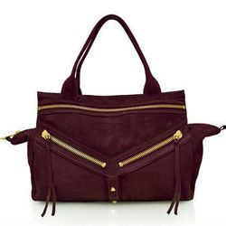 """Gold zipper accents and studs play gorgeously off deep plum. Botkier <a href=""""http://www.botkier.com/handbags/legacy-satchel-win"""">Legacy satchel</a>, $595."""