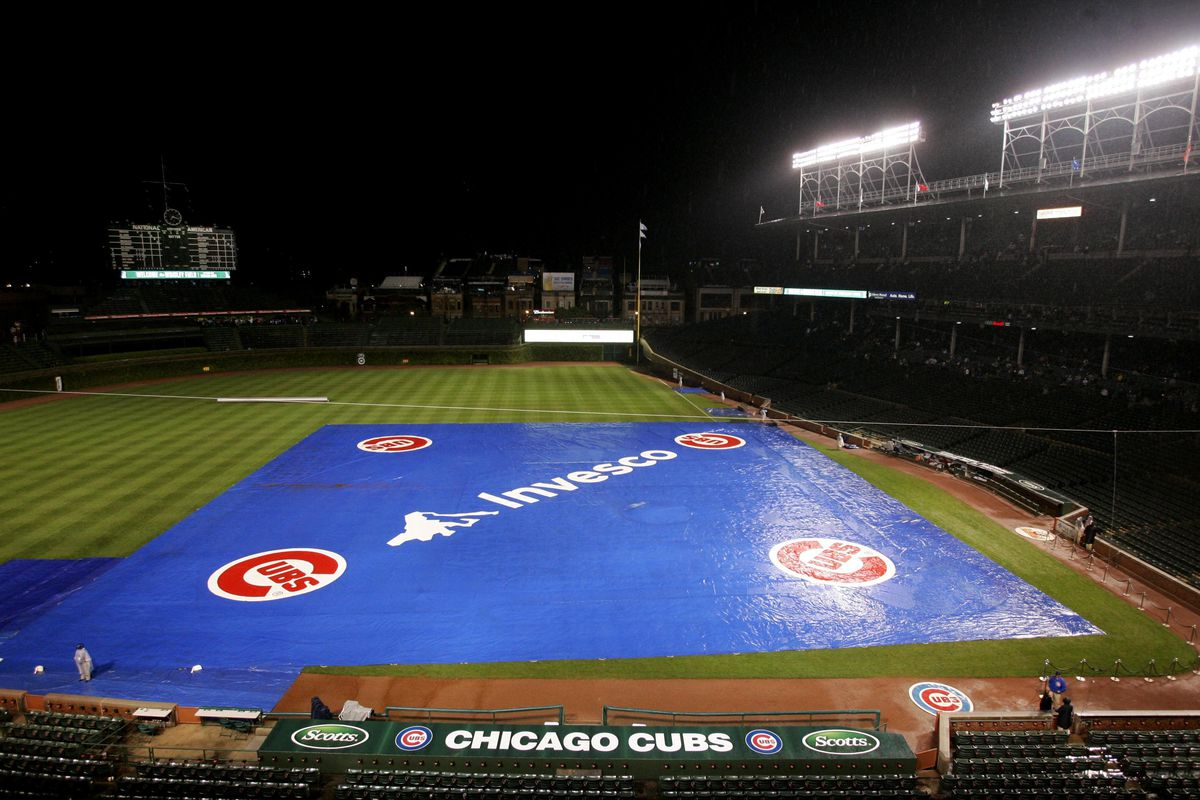 Chicago, IL, USA; A general view of a tarp on the field as rain delays the start of the game between the Chicago Cubs and the Pittsburgh Pirates at Wrigley Field. Credit: Jerry Lai-US PRESSWIRE