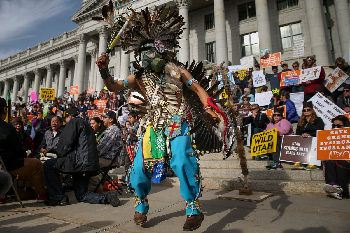 Carl Moore, chairman of Peaceful Advocates for Native American Dialogue and Organizing Support, dances during a rally in support of Bears Ears and Grand Staircase-Escalante national monuments at the state Capitol in Salt Lake City on Saturday, Dec. 2, 201
